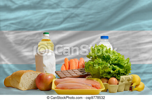 basic food groceries in front of argentina national flag - csp9778532
