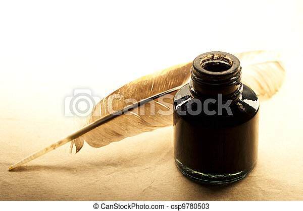 Feather and inkpot on paper - csp9780503