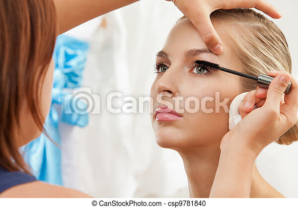Separating and curling lashes with mascara brush - csp9781840