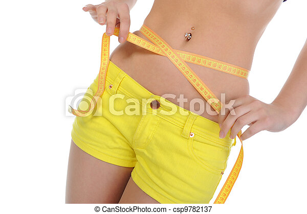 Young sports woman measuring waist. - csp9782137