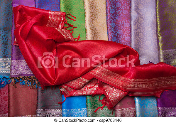 Red fabric on the counter - csp9783446