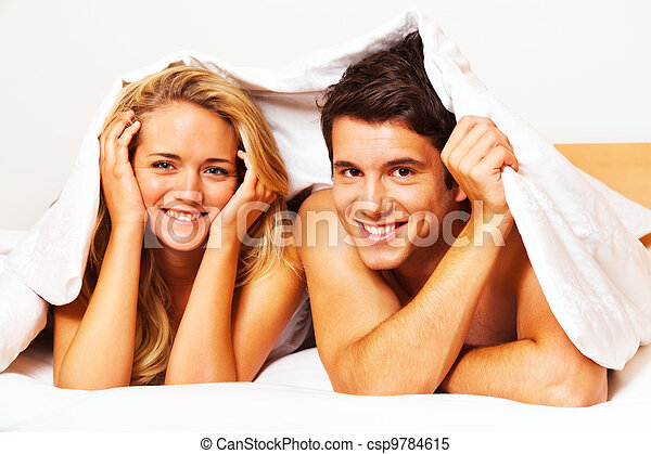 couple has fun in bed. laughter, joy and eroticism - csp9784615