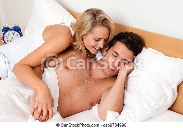 couple has fun in bed. laughter, joy - csp9784990
