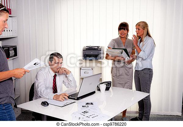 successful team in a meeting - csp9786220