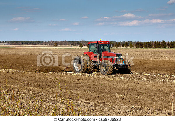 tractor cultivated fields - csp9786923