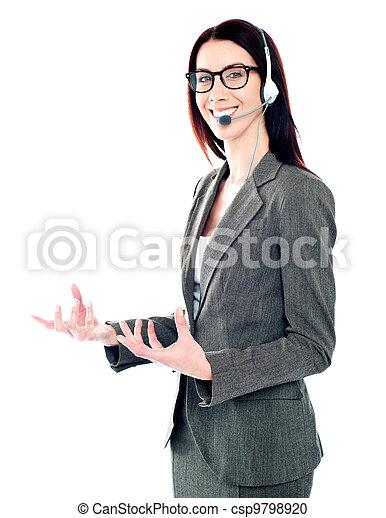 Smiling telemarketing girl posing in headsets - csp9798920