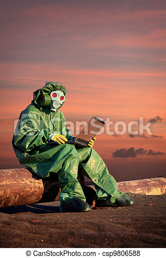 Man in protective suit works in contamination area - csp9806588