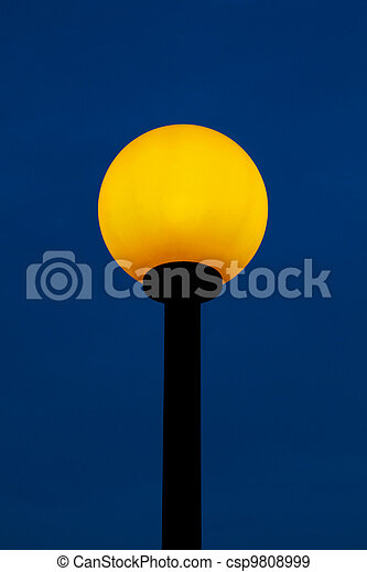 street lamp lit with yellow light - csp9808999