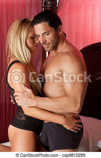Loving young nude erotic sensual couple in bed - csp9810289