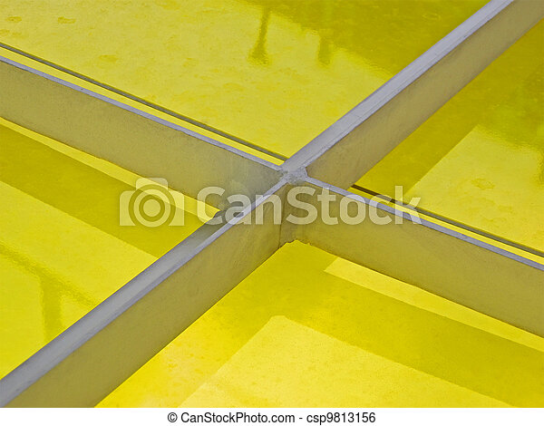 abstract metal construction covered with yellow material, industry details
