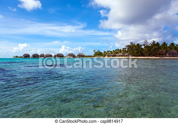 View on tropical island and small houses on the sea. Polynesia - csp9814917