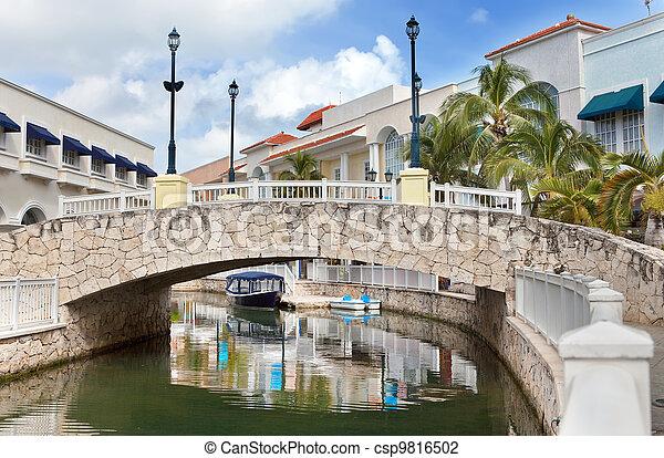 The stone bridge over the channel in tropics - csp9816502