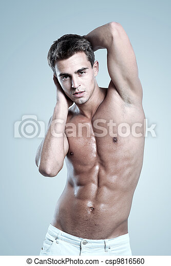 a young male model posing his muscles - csp9816560