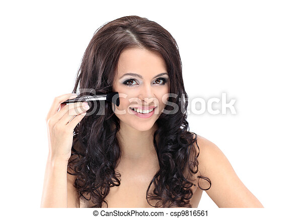 Portrait of attractive young adult woman applying blusher - csp9816561