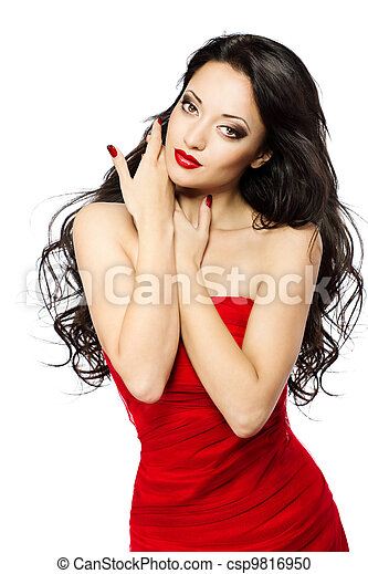 Beautiful woman portrait with red lips, long curly hairs in red dress over white background - csp9816950
