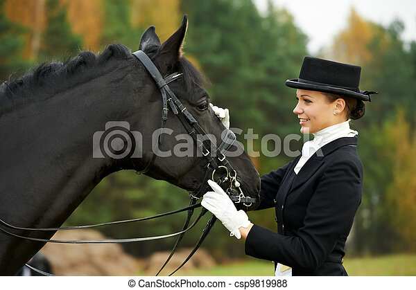 horsewoman jockey in uniform with horse - csp9819988