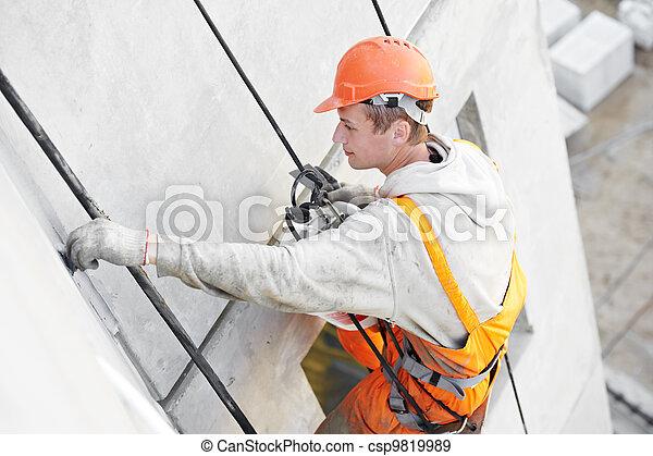 Facade Plasterer worker at work - csp9819989