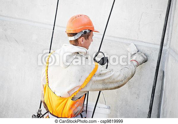 Facade Plasterer worker at work - csp9819999