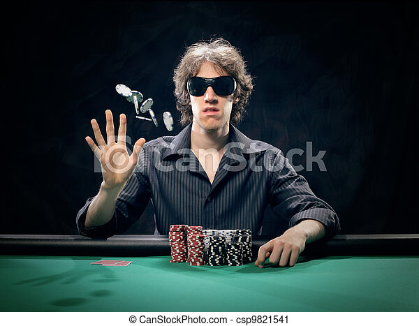Young poker player throwing chips - csp9821541
