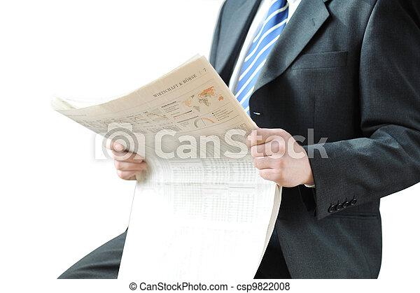 Businessman reading a newspaper - csp9822008