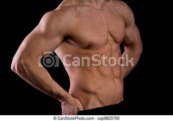 Muscular male torso of bodybuilder - csp9823700