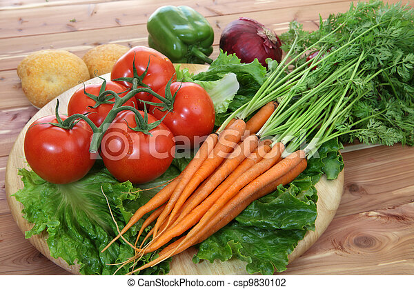 Organic vegetables in rustic setting - csp9830102
