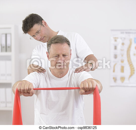 Physiotherapy: Senior man and physiotherapist - csp9836125