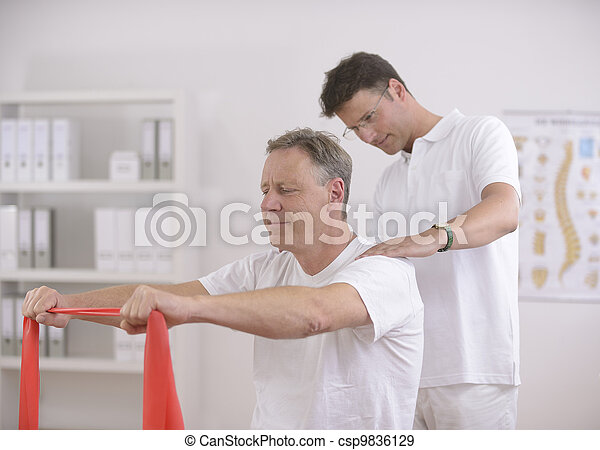Physiotherapy: Senior man and physiotherapist - csp9836129