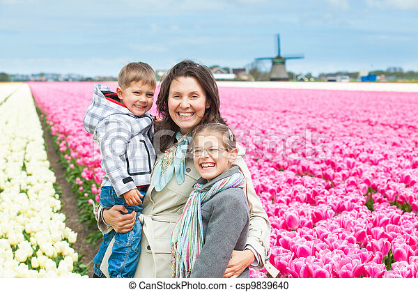 Mother with her child in tulips field - csp9839640