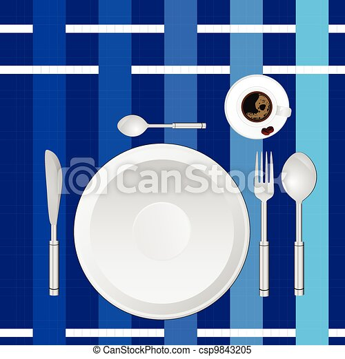 dinner service on a blue tablecloth - csp9843205