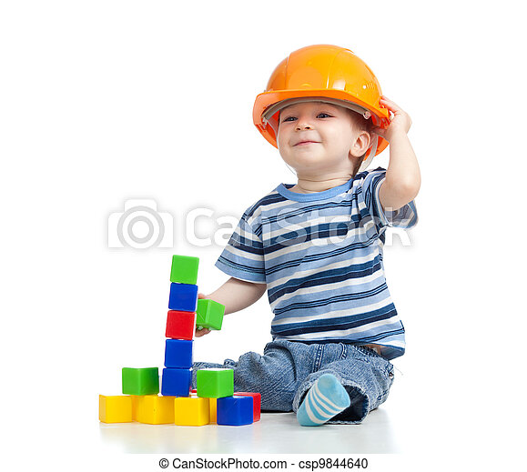 kid playing with building blocks toy - csp9844640