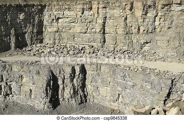 stone pit walls in sunny ambiance - csp9845338