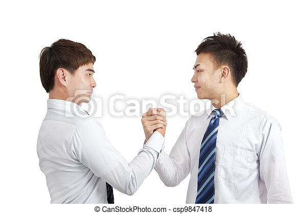 two businessmen holding hand for cooperation - csp9847418