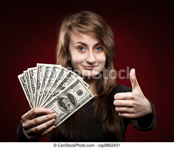 woman showing fan of money - csp9852431