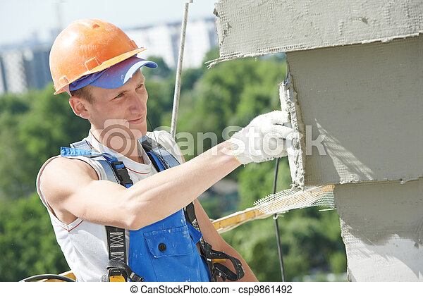 facade builder plasterer at work - csp9861492