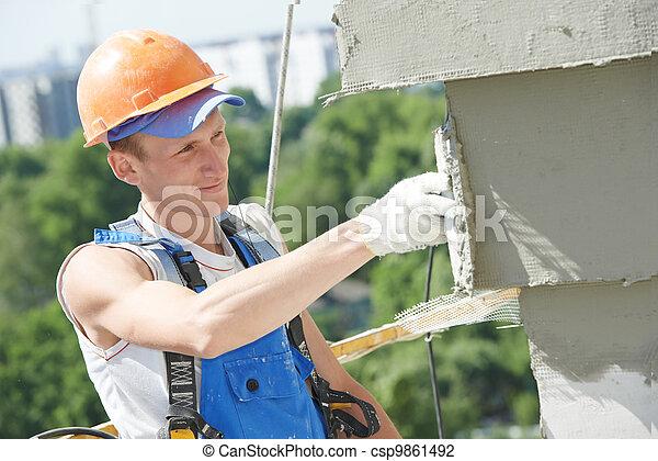 facade builder plasterer at work - csp9861492