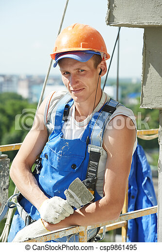 facade builder plasterer at work - csp9861495