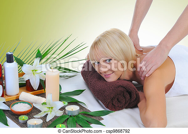 Young woman at spa procedure - csp9868792