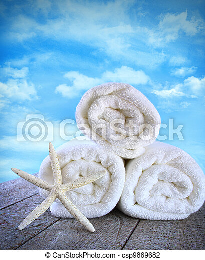 Fluffy fresh towels againt a blue sky - csp9869682