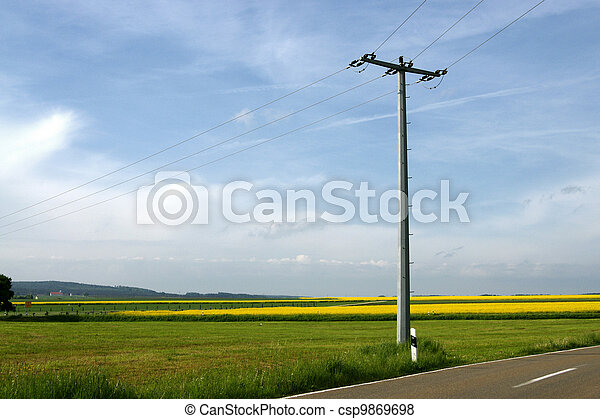 electricity pole in rural field - csp9869698
