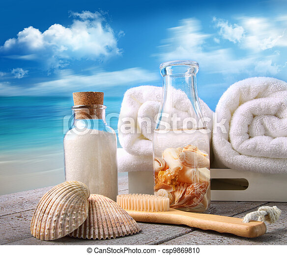 Towels with bath accessories at the beach - csp9869810