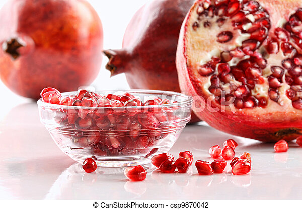 Pomegranates with bowl of seeds  - csp9870042