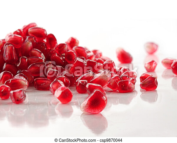 Ripe pomegranate seeds on white - csp9870044