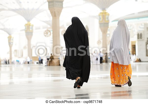 Two Muslim Arabic women walking - csp9871748