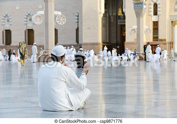 Muslim prayer at holy mosque - csp9871776