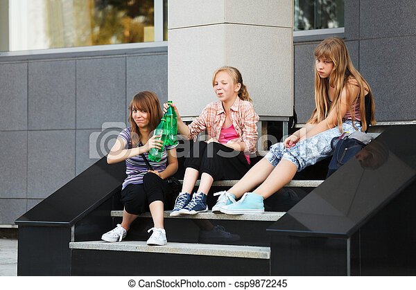Teenage girls relaxing on a school steps - csp9872245