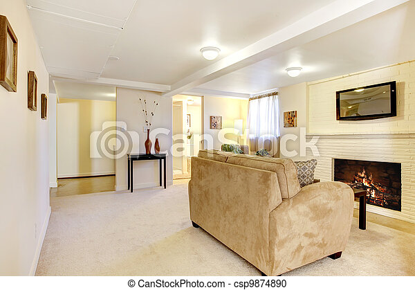 Basement bright living room with fireplace. - csp9874890