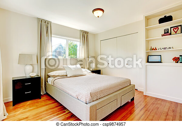 White bedroom with hardwood cherry floor. - csp9874957