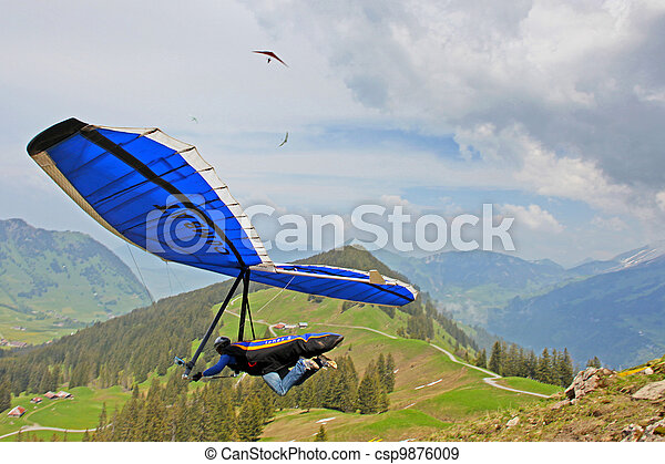 SANTS, SWITZERLAND - May 27: Competitor  Ievgen Lysenko from Ukraine of the Swiss Masters hang gliding competitions takes part on May 27, 2012 in Sants, Switzerland  - csp9876009