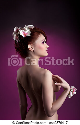 Beautiful nude redheaded woman with flowers - csp9876417